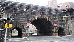 East 105th Street tunnels through Metro-North viaduct from west.jpg