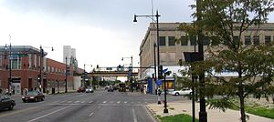 Englewood, Chicago - The intersection of 63rd and Halsted, looking south.  The Halsted 'L' station can be seen crossing Halsted in the distance.  Kennedy-King College occupies the buildings on the left of the photo.  The building on the right burned in 2014.