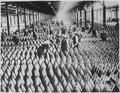 English women in munition factory. Women and men working in storage shed for large shells. In most of the munition cente - NARA - 522871.tif