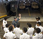 Ensign Jack Morgenthaler, from Philadelphia, discusses landing craft, air cushion operations with Sailors from the Indian navy frigate INS Trikand (F51) during a tour of USS Pearl Harbor (LSD 52) as part of a scheduled port visit.jpg