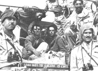 1948 in Mandatory Palestine - Arab Legion commander Abdullah el Tell (far right) with Captain Hikmat Mihyar (far left) pose with Jewish prisoners after the Fall of Gush Etzion, May 1948