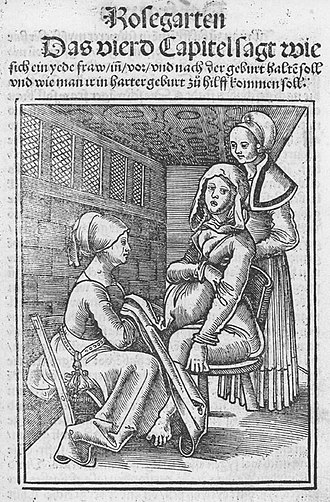 Obstetrics - Two midwives assisting a woman in labour on a birthing chair in the 16th century, from a work by Eucharius Rößlin.