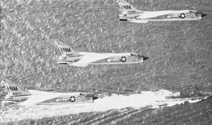 F-8Js VF-191 in flight over destroyer c1972.jpg