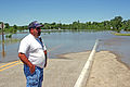 FEMA - 35670 - Iowa Assistant Police chief looking at flood waters.jpg