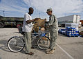 FEMA - 38341 - A resident speaks to a National Guardsman at a food distribution center in Texas.jpg