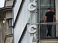Facade with Man in Window - Kaunas - Lithuania (27328899903) (2).jpg