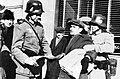 Fake Nazi soldiers assaulting a Winnipeg Free Press newsie, 19 February 1942.jpg