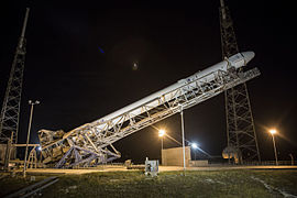 Falcon 9 with CRS-5 Dragon being erected at SLC-40 pad (16513369059).jpg