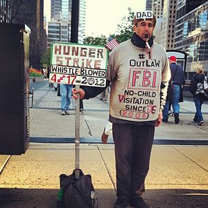Farhad Khoiee-Abbasi - Protesting across the street from Union Station in front of CDW Plaza.