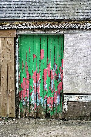 English: Farm Door A near-rainbow of peeling p...