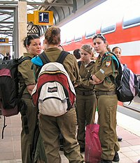 Female soldiers at the train station
