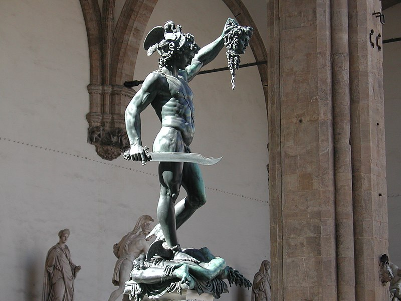 Perseus depicted as wearing the Helm of Darkness and holding Medusa's head.