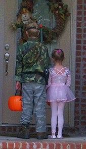 two children trick or treating on halloween in arkansas united states