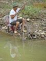 Fisherman at River's Edge - Cao Bang - Vietnam (48113281632).jpg