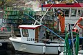 Fisherman cleaning lobster traps in Norra Grundsund 1.jpg