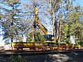 Flatcar with excavator for Caltrain electrification, August 2018.JPG