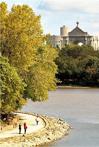 Winnipeg - River walkway near The Forks, with St. Boniface Cathedral in the background