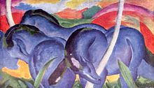 A painting of three blue horses beneath a sky of purple, red, and yellow