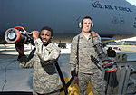 From left, U.S. Air Force Airman Derrick Harris and Airman 1st Class Jacob Walker, both with the 436th Logistics Readiness Squadron, are photographed after refueling a C-5 Galaxy aircraft at Dover Air Force 131002-F-VV898-043.jpg