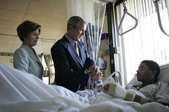 Walter Reed Army Medical Center - President George W. Bush and First Lady Laura Bush visit Sgt. Patrick Hagood of Anderson, SC on October 5, 2005