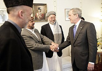 Mohammed Fahim - Marshal Fahim greeting former U.S. President George W. Bush in 2006. Others to the side are Afghan President Hamid Karzai and 2nd Vice Afghan President Karim Khalili with the turban.