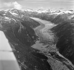 Gilkey Glacier, disarticulated terminus of valley glacier with glacial remnents and hanging glaciers on the mountainsides (GLACIERS 6316).jpg
