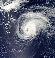 A satellite image of a well-defined hurricane over the open Atlantic Ocean