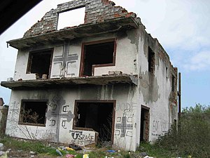 House demolition - A destroyed house in Croatia marked with Serbian nationalist symbols and graffiti