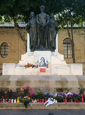 Daphne Caruana Galizia - Flowers, candles and tributes to Daphne Caruana Galizia left at the foot of the Great Siege Monument, opposite the Law Courts in Valletta.