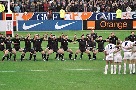 A haka performed by the national rugby union team before a game Haka 2006.jpg