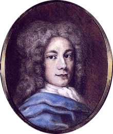 Oval portrait of a young man with long locks, facing the viewer, with a little blue of a jacket and a white scarf showing