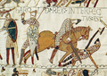 The death of King Harold, from the Bayeux Tapestry.  The shields look heraldic, but do not seem to have been personal or hereditary emblems.