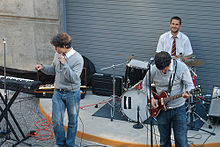 Photograph of a group playing instruments in an amphitheater.