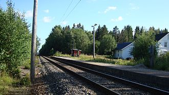 Eastern Østfold Line - Heia Station was typical for new stations established in 1928, with a simple shed and platform near a level crossing