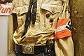 Hitlerjugend uniform; belt buckle (Blut und Ehre), swastika armlet, HJ-dagger, DJ pin (Deutsche Jungvolk), Jungvolk badge (siegrune), H. J. Deutsche Arbeiter-Jugend pin, etc. Lofoten Krigsminnemuseum (WW2 Memorial Museum) Norway 2019-05.jpg
