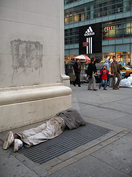 Juxtaposition of homeless and well off is common on Broadway, New York City Homeless person in New York City.jpg
