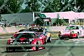 Honda & Porsche at the Ford Chicane at the 1994 Le Mans (31596690700).jpg