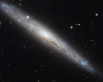 Hubble portrays a dusty spiral galaxy.jpg
