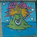 Human Eating Volcano Street Art (31409342922).jpg