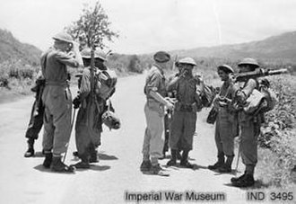Battle of Imphal - Troops of Indian 5th Division and British 2nd Division meet at Milestone 109, to raise the siege of Imphal