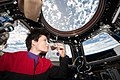 ISS-43 Samantha Cristoforetti drinks coffee in the Cupola.jpg