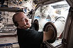 ISS-55 Scott Tingle works with the glovebox inside the Destiny lab.jpg