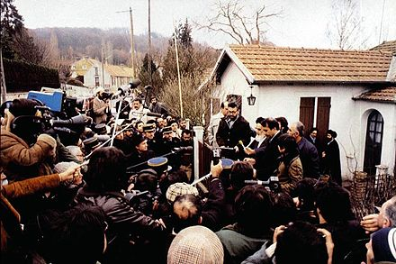Ayatollah Khomeini in front of his house at Neauphle-le-Chateau in a media conference Imam in Paris.jpg