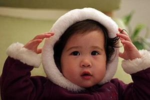 Hood (headgear) - An infant wearing a hood.