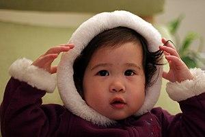 Hood (headgear) - An infant wearing a hood.