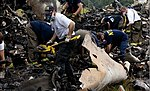 Investigators combing through wreckage from UPS flight 1354 (9516184287).jpg