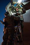 JSTARS crew chiefs perform pre-flight inspection on E-8C Joint STARS 160406-Z-XI378-007.jpg
