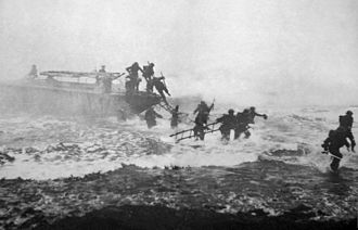 LCPL - A Eureka Boat, an early model of the LCP(L), used in commando raids. This image features Jack Churchill leading a charge armed with a broadsword (far right).