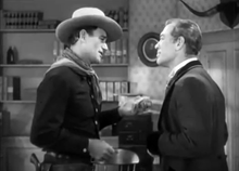 John Wayne and Ward Bond in Tall in the Saddle.png