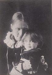 Photo of Julia Stephen with Virginia on her lap in 1884